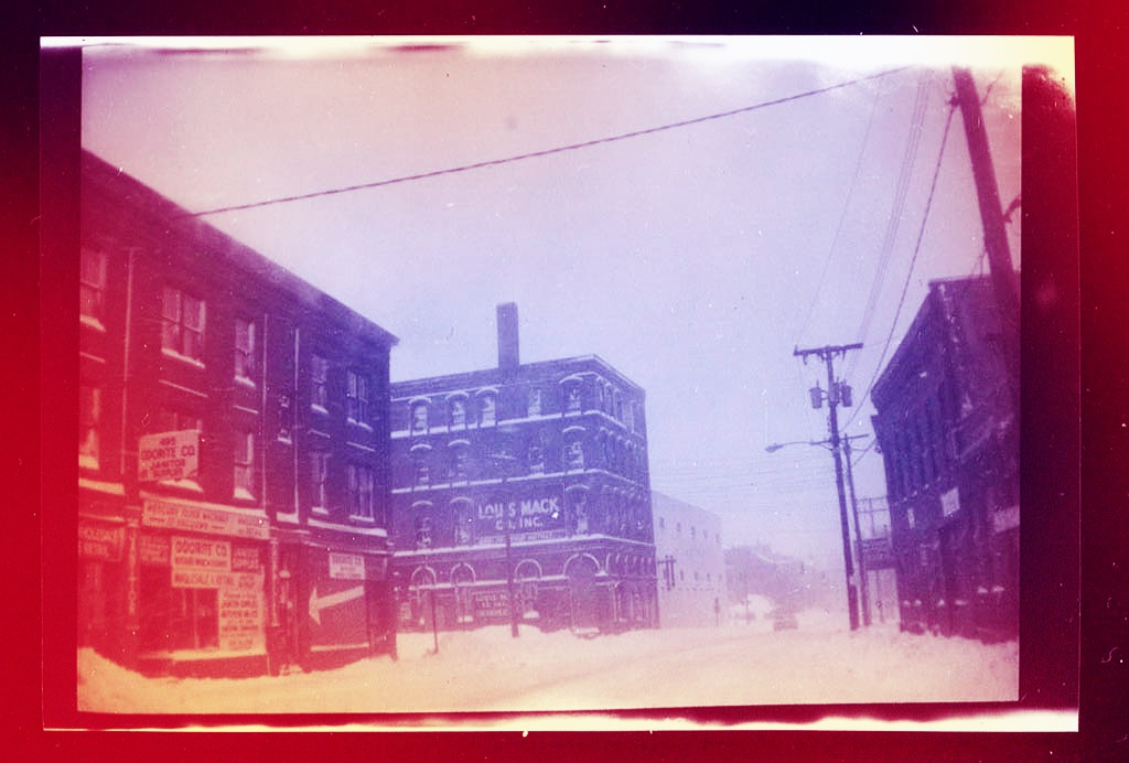 In a digitally colorized image suitable to the holiday season, here is Fore Street in Portland, Maine, early in 1982. The camera was a Kodak Brownie from the 1920s or '30s that I kept in the Squareback. I was on my way to work in the clip library at the Guy Gannett newspapers on a Saturday morning. Hubley Archives.