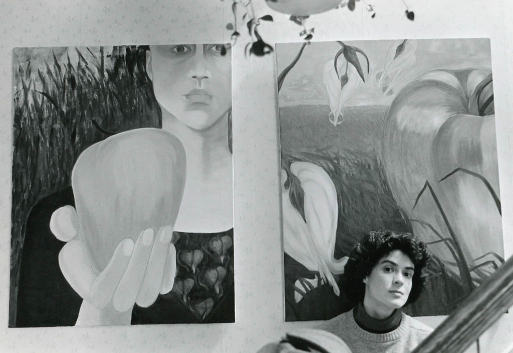 Gretchen with two of her paintings in 1986. Hubley Archives.