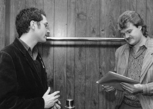 Backstage at the Cumberland County Civic Center in 1985, I give Ricky Scaggs copies of my Sunday Telegram article about him.