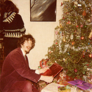 Me under the Hubley Christmas tree in the mid-1970s. My sister Nancy has her back to the camera. Hubley Family photo.