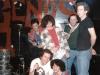 Exuberance after a Fashion Jungle gig at Geno\'s, 1987 or 1988. Clockwise from upper left: drummer Ken Reynolds,  Jeri Chapman, Alden Bodwell, bassist Steve Chapman, Gretchen Schaefer, guitarist Doug Hubley. Photograph by Jeff Stanton.