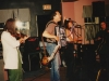 This image is dated 1992 because Gretchen was still using my 1968 Hagstrom bass, visible on the stand behind me.  Later that year she bought a Fender. Jonathan Nichols-Pethick is at far left and Gretchen Schaefer at far right. In between are Melinda McCardell, DH, Marcia Goldenberg. Photo by Jeff Stanton.