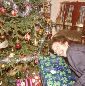 We all look for that Christmas feeling in our own ways. Me exaggerating my greed, but not by much. Circa 1979. Hubley Family photo.