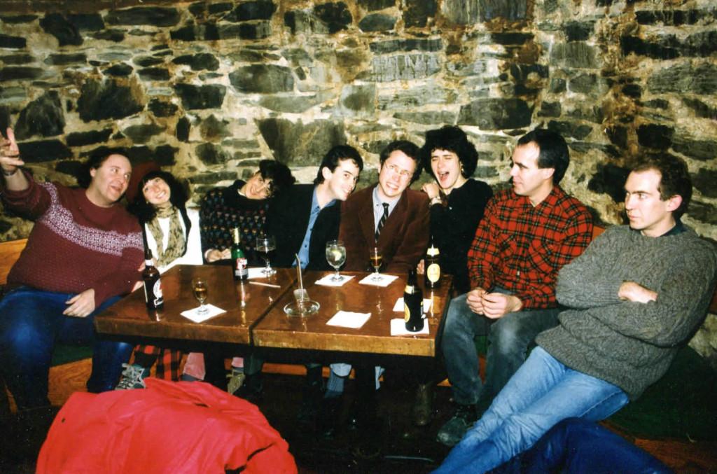 The cronies at the Bramhall Pub, late 1980s. From left: Alden Bodwell, Kathren Torraca, Elizabeth Torraca, Ken Reynolds, Doug Hubley, Gretchen Schaefer, Jeff Stanton, Steve Chapman. Photographer: Jeri Chapman.