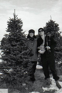 Posing with our prey at Merry Christmas Trees, Windham, in 1994. Photo by self-timer/scanned from black & white negative.