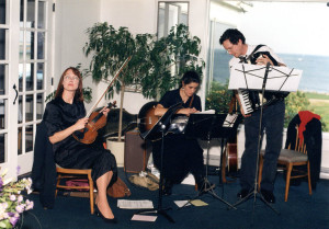 Cowlix gone rogue: Melinda, Gretchen and Doug playing obscure folk music at a wedding in October 1993.