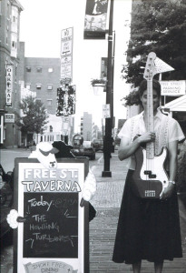 Long-necked woman with a black skirt: Howling Turbines bassist Gretchen Schaefer at the Free Street Taverna, Aug. 1, 1999. Photo by Jeff Stanton.