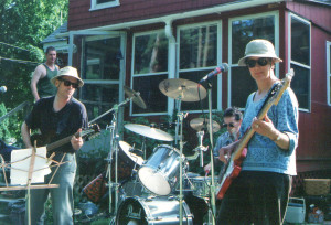 With our host Bob Gallagher shown at upper left, the Howling Turbines perform at a party circa 2002. Photo by Jeff Stanton.