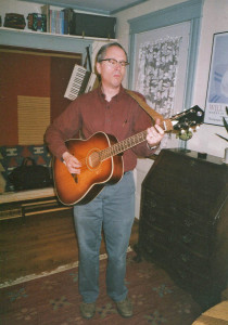 The venerable Silvertone in 2005, 34 years after I got it. Gretchen took this image the night before I sold the guitar to a Bates College student from Rwanda, who sent it home as a gift to her boyfriend. I wonder how it's doing.