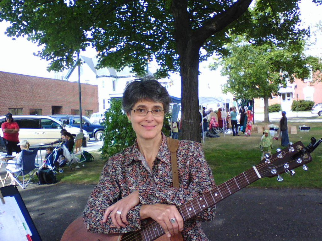 Gretchen Schaefer poses for a cell-phone picture during Day for Night's first performance, at the Lewiston (Maine) Farmers Market in July 2007. Hubley Archives